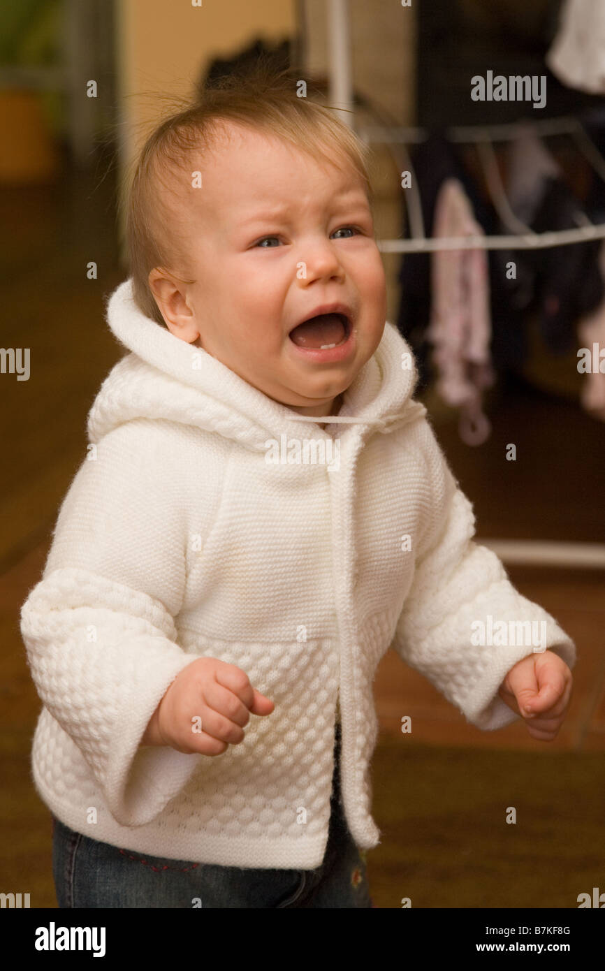 Ten Month Old Baby Crying - Stock Image