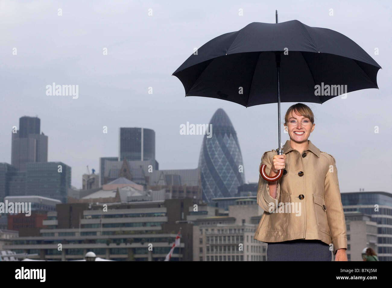 Woman with umbrella city scape - Stock Image