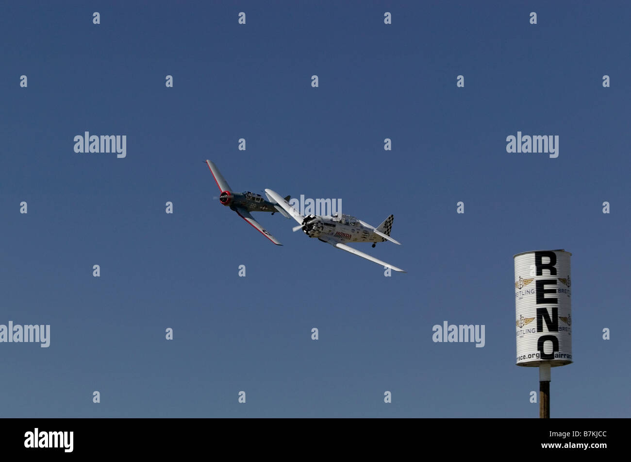 Two second world war trainer aircraft racing around pylon at Reno air Races 2008 Stock Photo