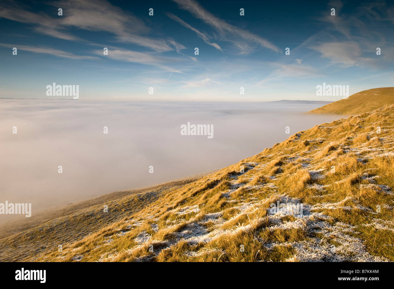 Winter view over Upper Eden valley from Tailbrigg with the valley covered in mist Grass in foreground covered in - Stock Image