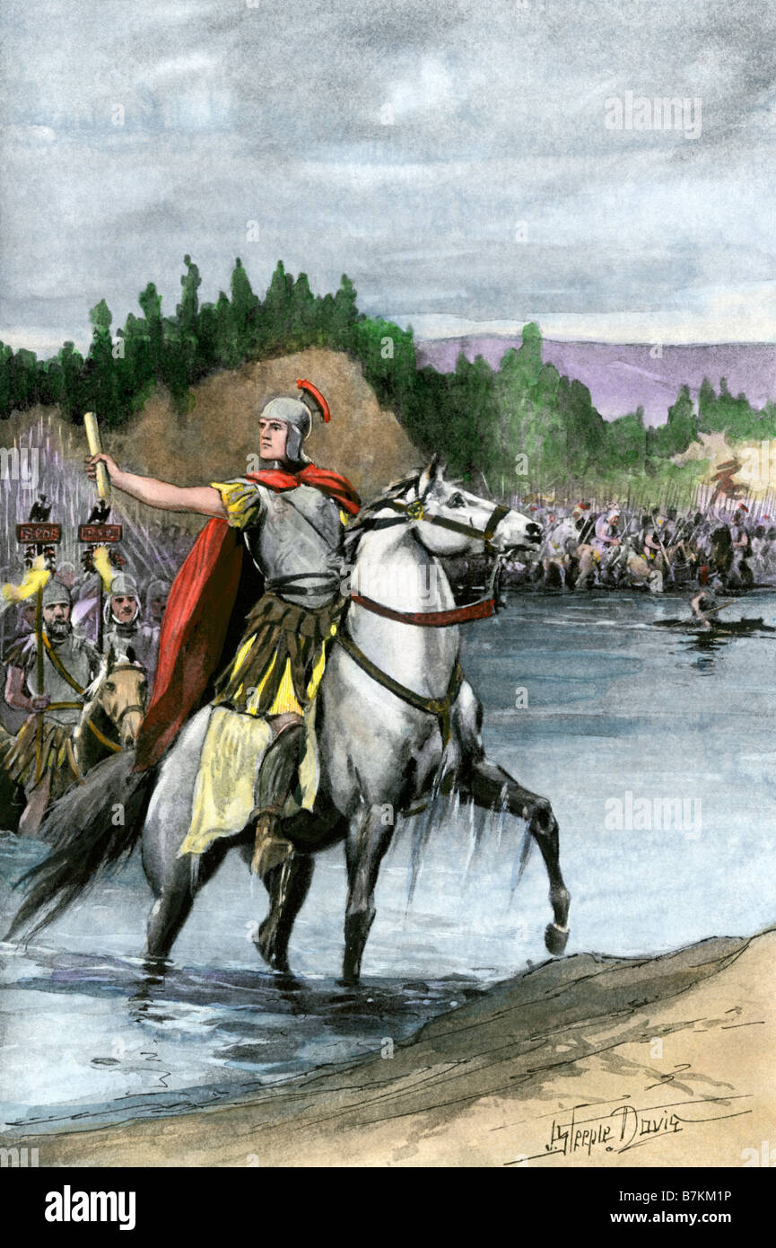 Julius Caesar crossing the Rubicon to begin a civil war in 49 BC. Hand-colored halftone of an illustration - Stock Image