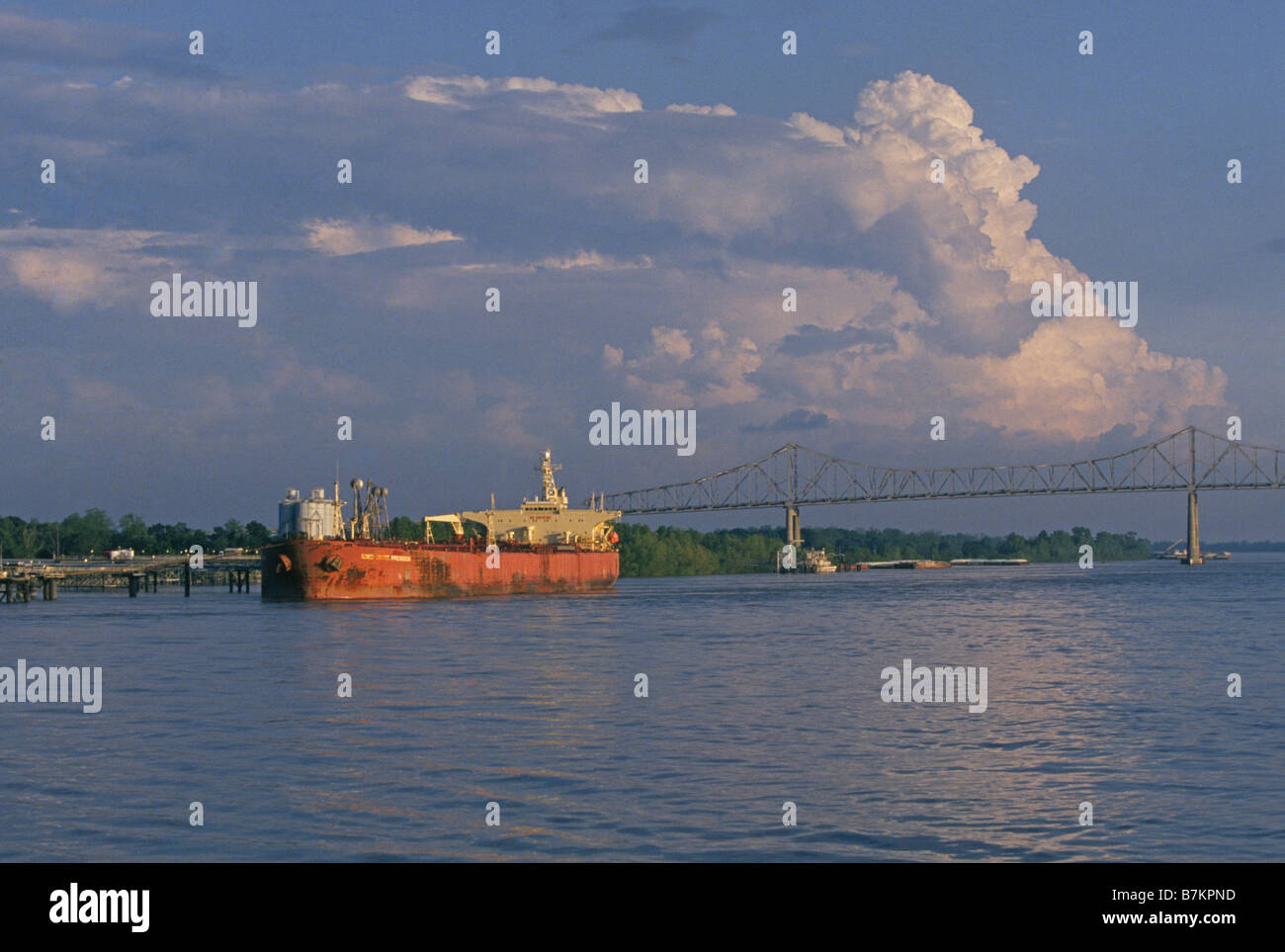 A small tanker takes on refined fuel at a dock on the Mississippi River north of New Orleans Stock Photo