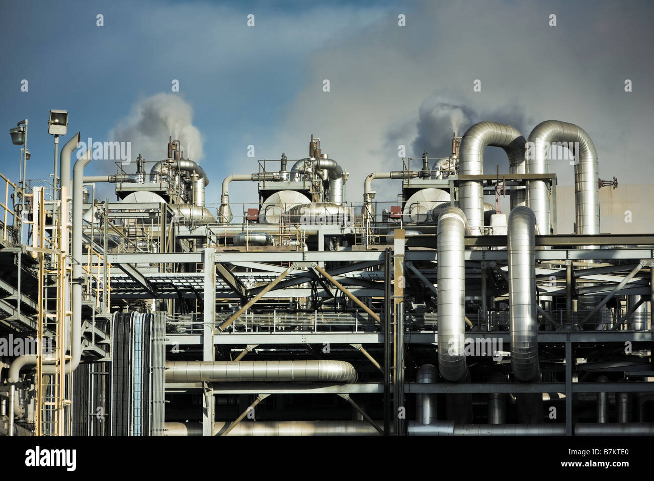 Maze of steel pipes and chimneys inside the facility at a modern gas fired power station plant, UK Stock Photo