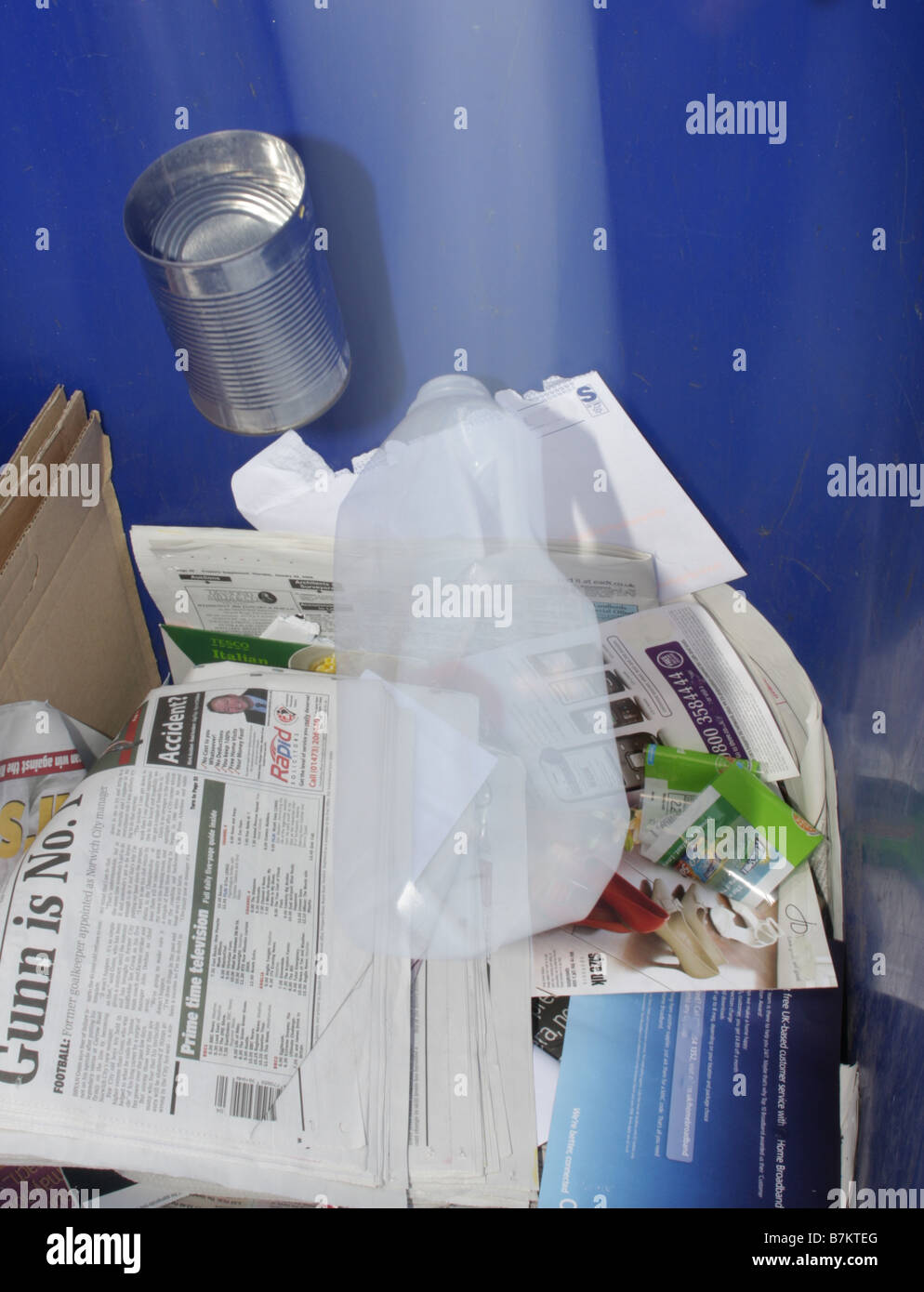 waste paper cans and plastic falling into recycle bin - Stock Image