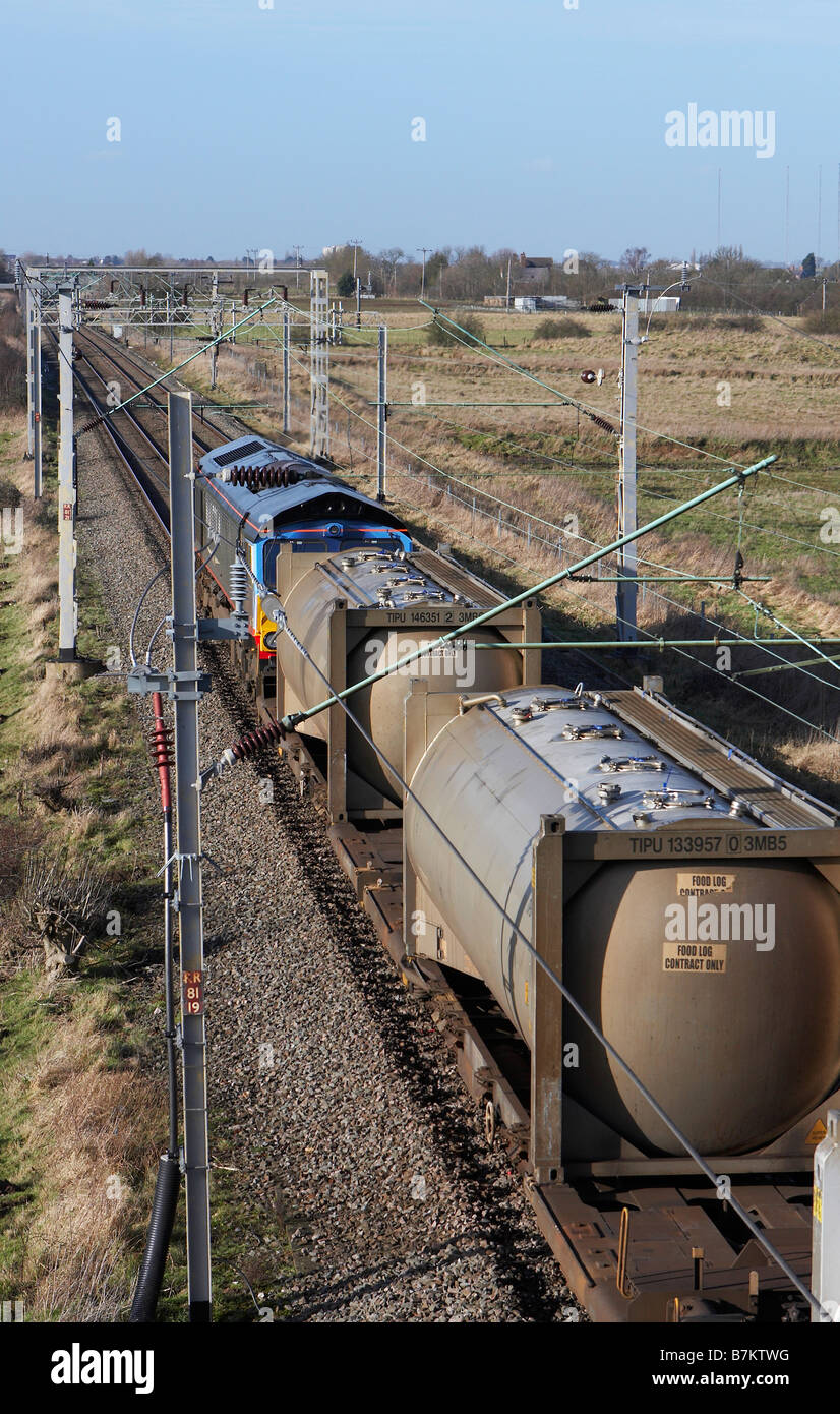 DRS Malcolm Class 66 heads north up the west coast mainline with an intermodal train - Stock Image