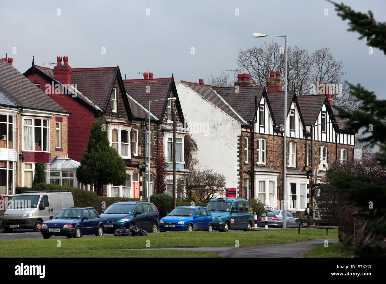 Urban Housing with parked cars - Stock Image