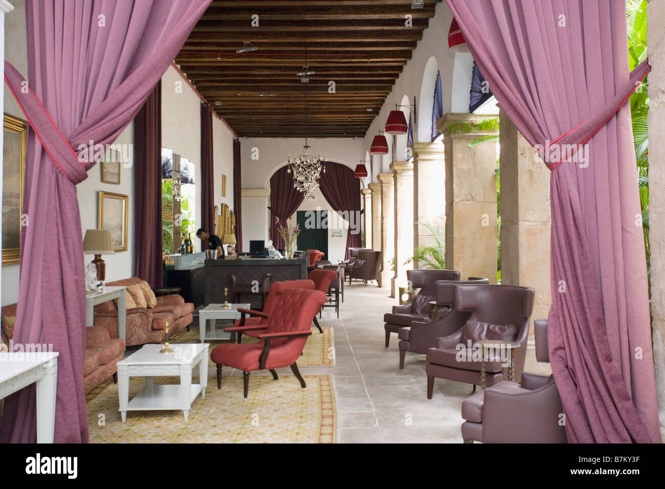 Pink Curtains And Comfy Chairs In Lounge On Veranda Of Hotel In Stock Photo Alamy