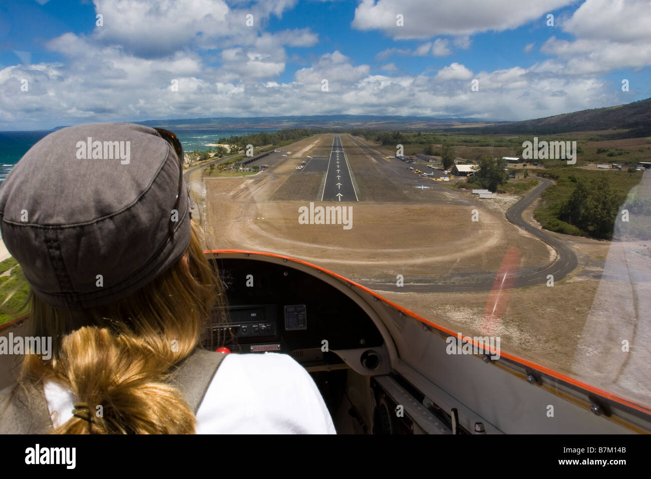 Female pilot in glider airplane approaching runway for arrival at Dillingham Airfield in Oahu Hawaii - Stock Image