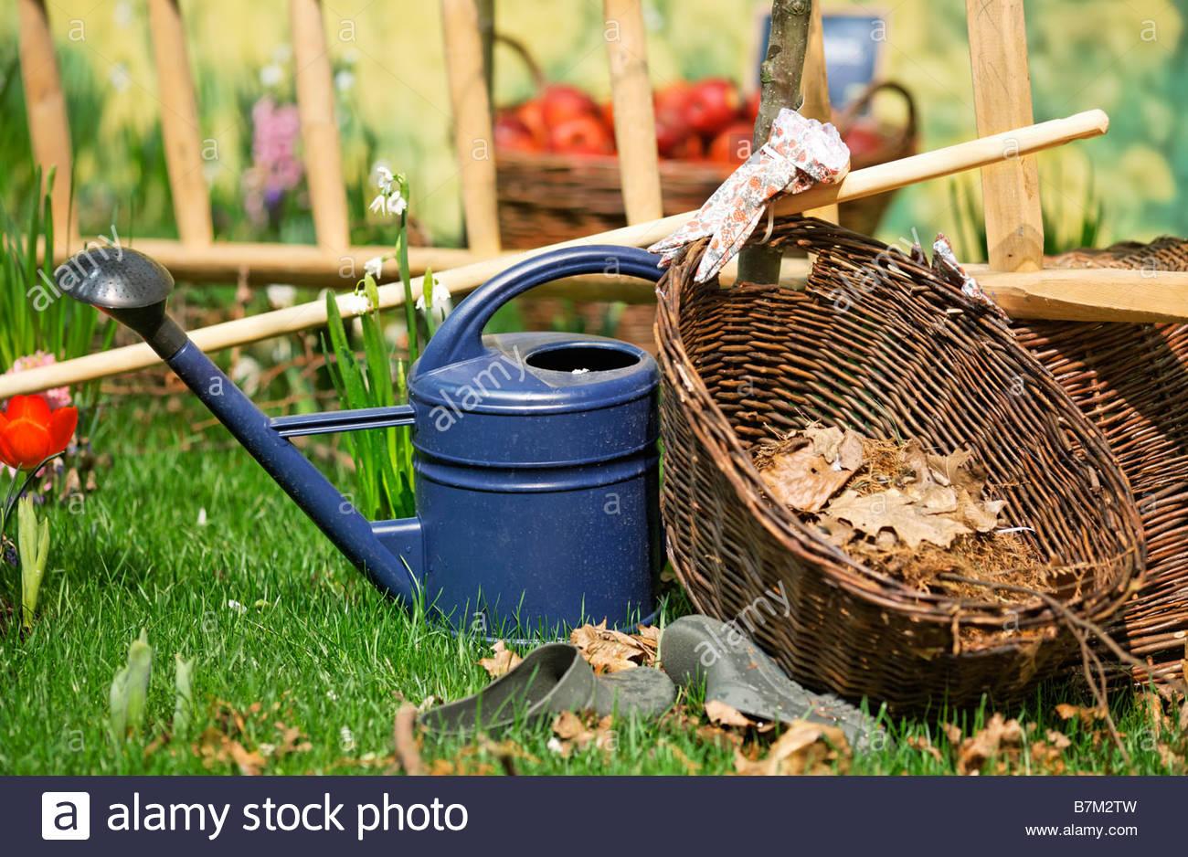 gardener utensils: ewer, basket, ladder, gloves, rubber shoes Stock Photo