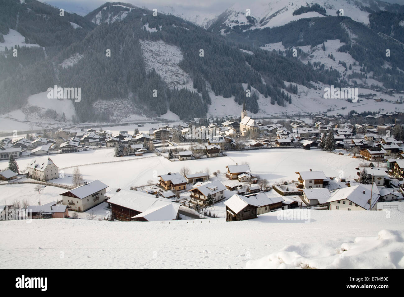 Rauris Austria EU January View down on this ski resort town as the sunshine spreads along the Rauriser Sonnen Valley - Stock Image