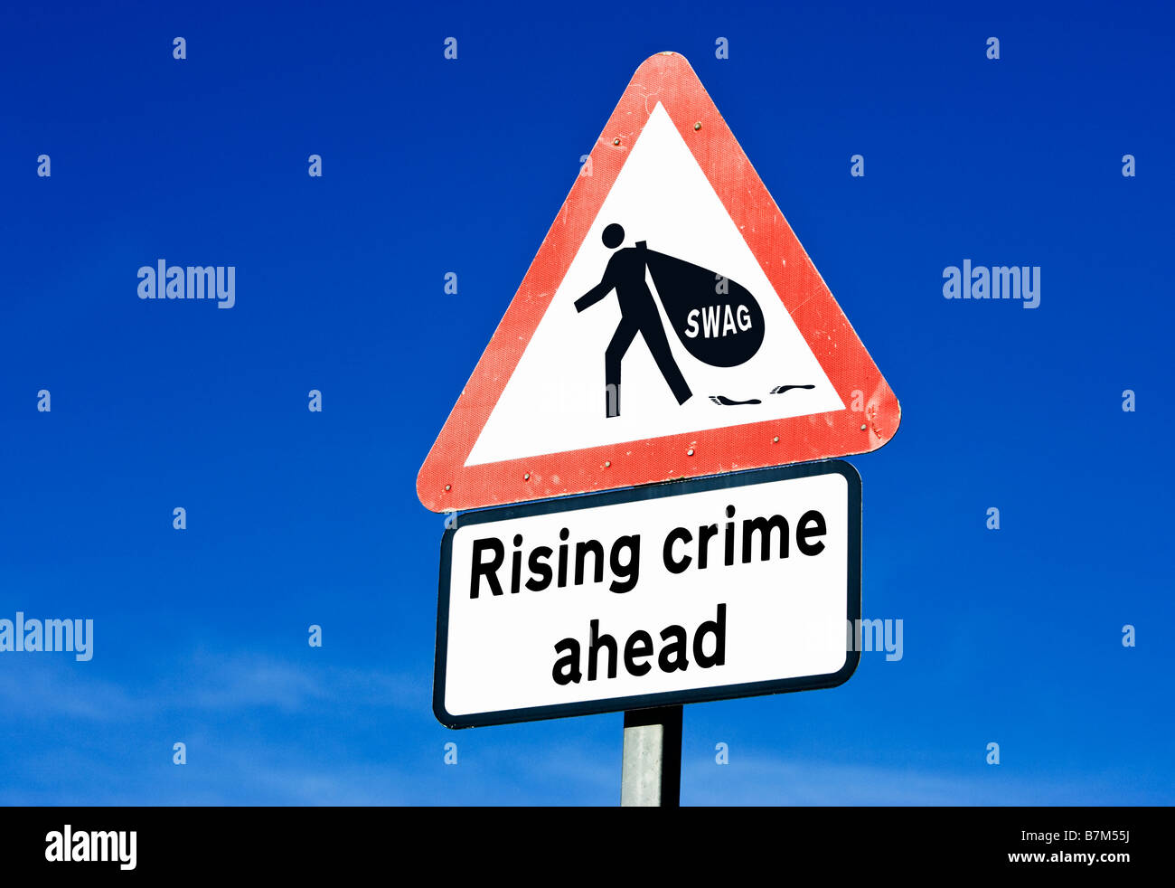 Rising crime ahead UK against a blue sky - Stock Image