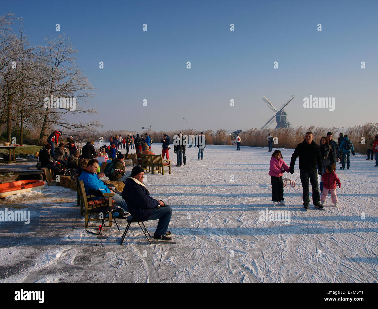 Many people skating and resting on the ice near Oud Alblas Zuid Holland the Netherlands - Stock Image