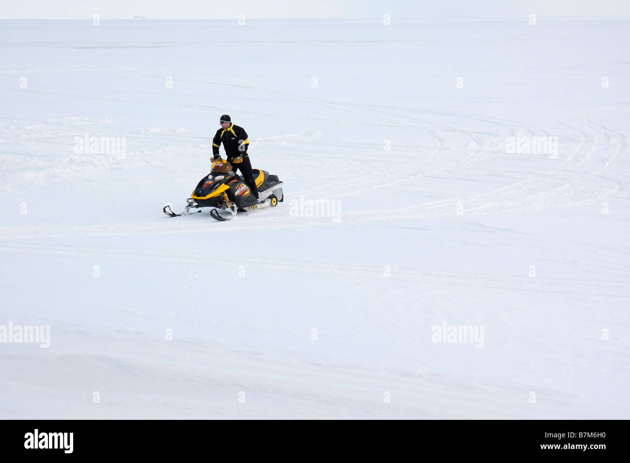 The snowmobiler drive on snowmobile on frozen Lake Erie in Ohio USA - Stock Image
