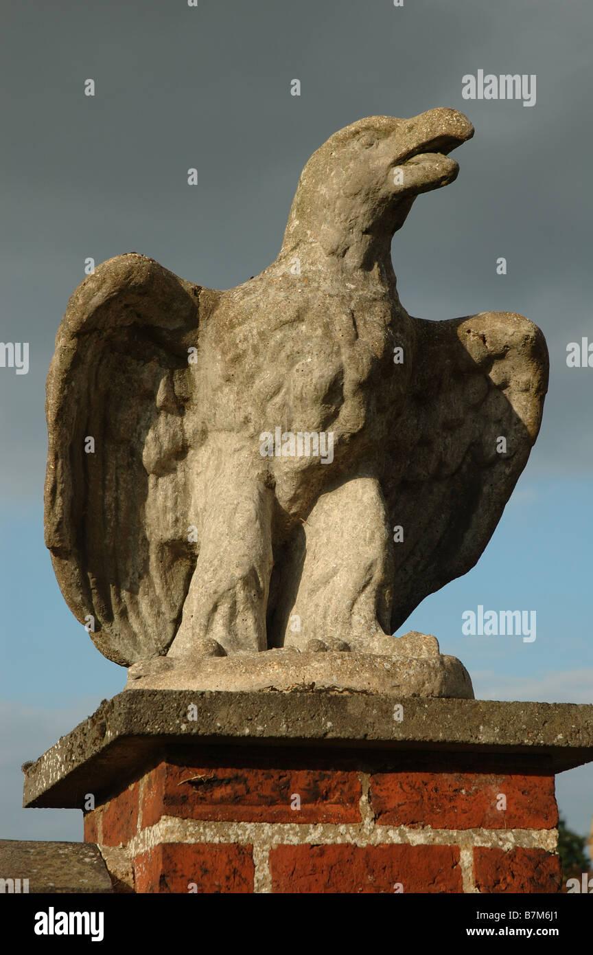 eagle statue on gatepost, Clipston, Northamptonshire, England, UK - Stock Image