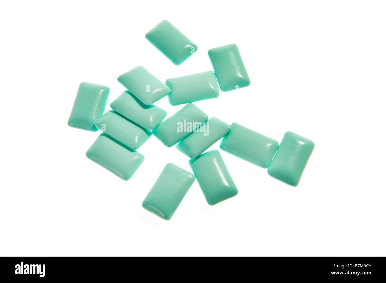 chewing gum bubble gum green blue cyan on white background pieces jelly baby candy jelly babies gum gummi fresh - Stock Image