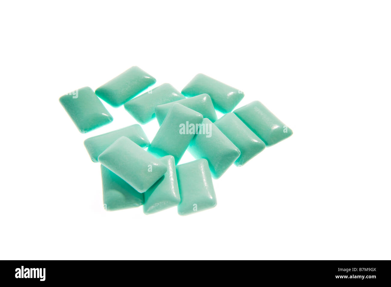 chewing gum bubble gum grenn blue cyan on white background pieces jelly baby candy jelly babies gum gummi fresh - Stock Image
