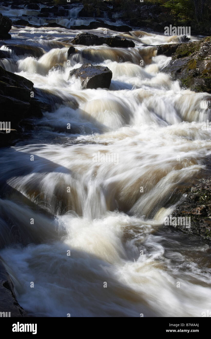 Rapid water travelling down the Falls of Dochart Killin The Trossachs Scotland - Stock Image