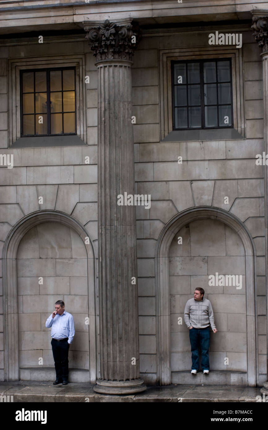 smokers shelter under the arches of the bank of england threadneedle street - Stock Image