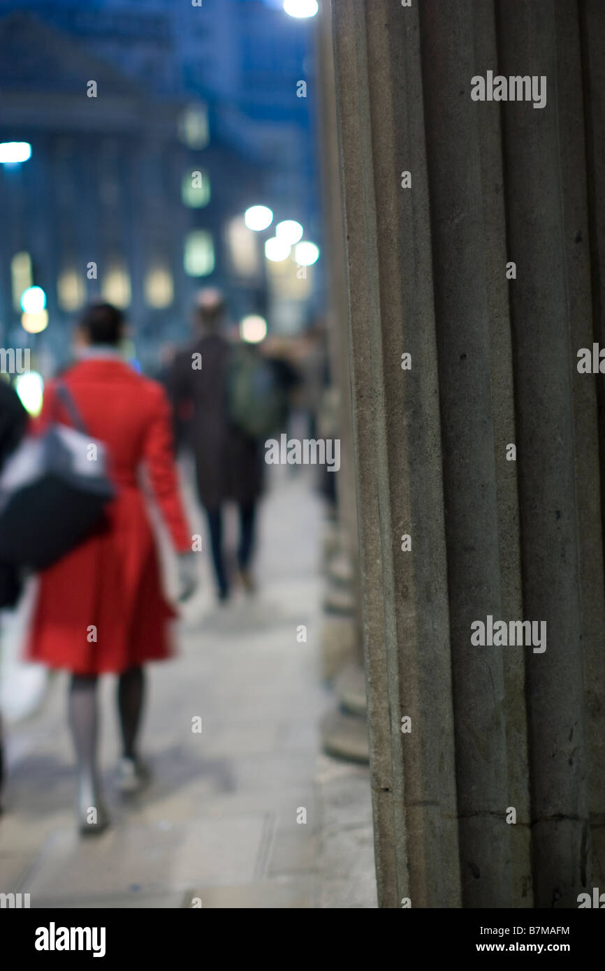 pillars of the bank of england threadneedle street city of london with commuters on their way home during the evening - Stock Image