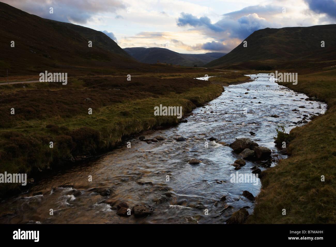 Clunie Water running through Grampian Mountains at dusk Aberdeenshire Scotland - Stock Image