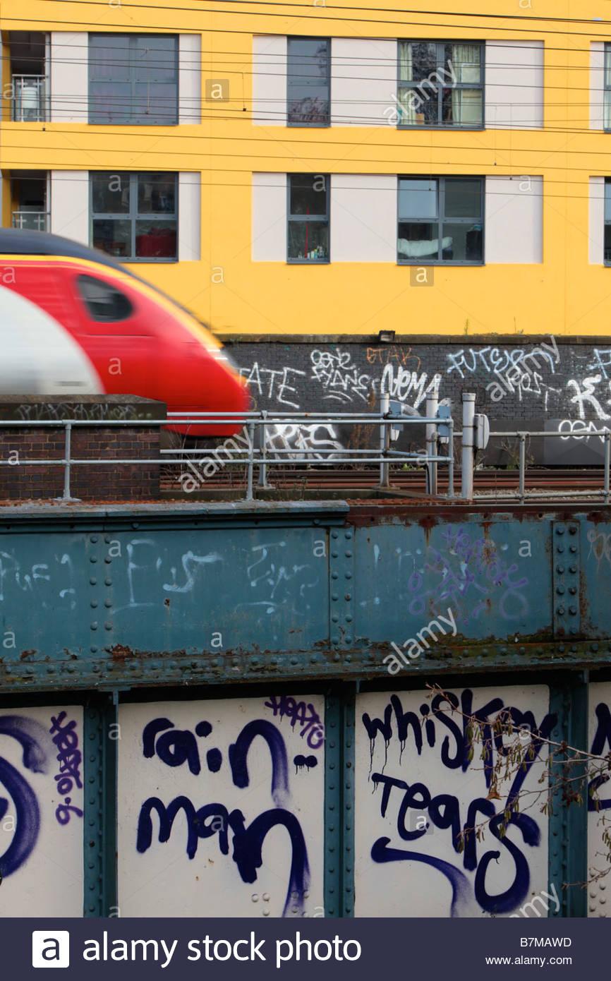 Virgin train crossing bridge over Regents Canal between Camden Town and Primrose Hill North London England - Stock Image