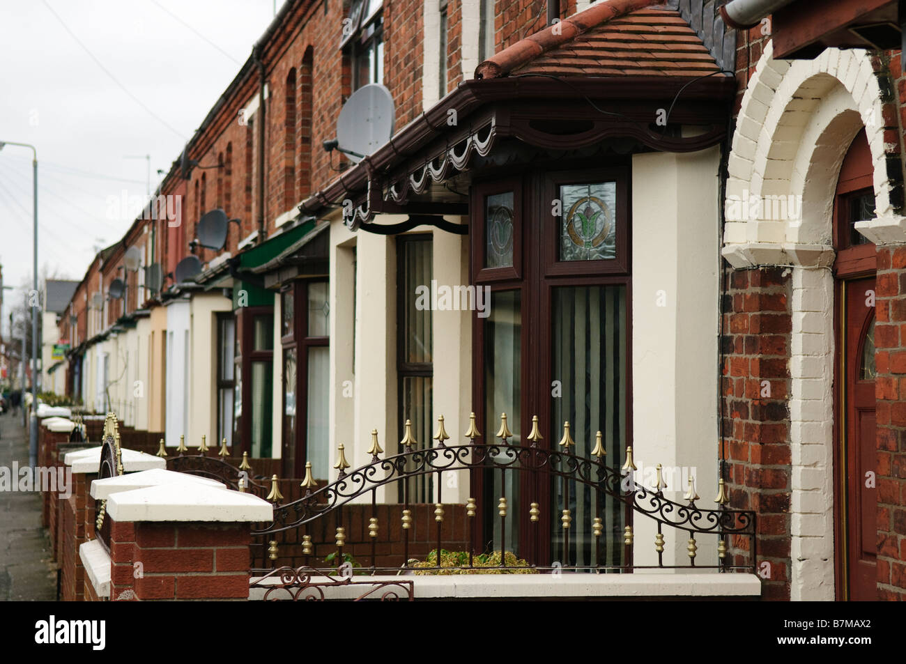 Row of terraced houses on a street in Belfast. - Stock Image