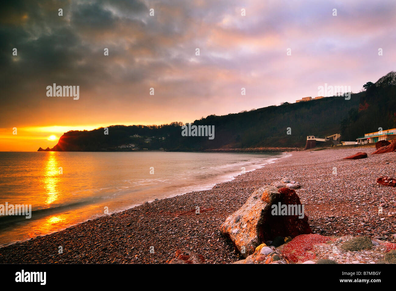 Sunrise from Oddicombe Beach in Torquay in South Devon England looking South along the coast Stock Photo