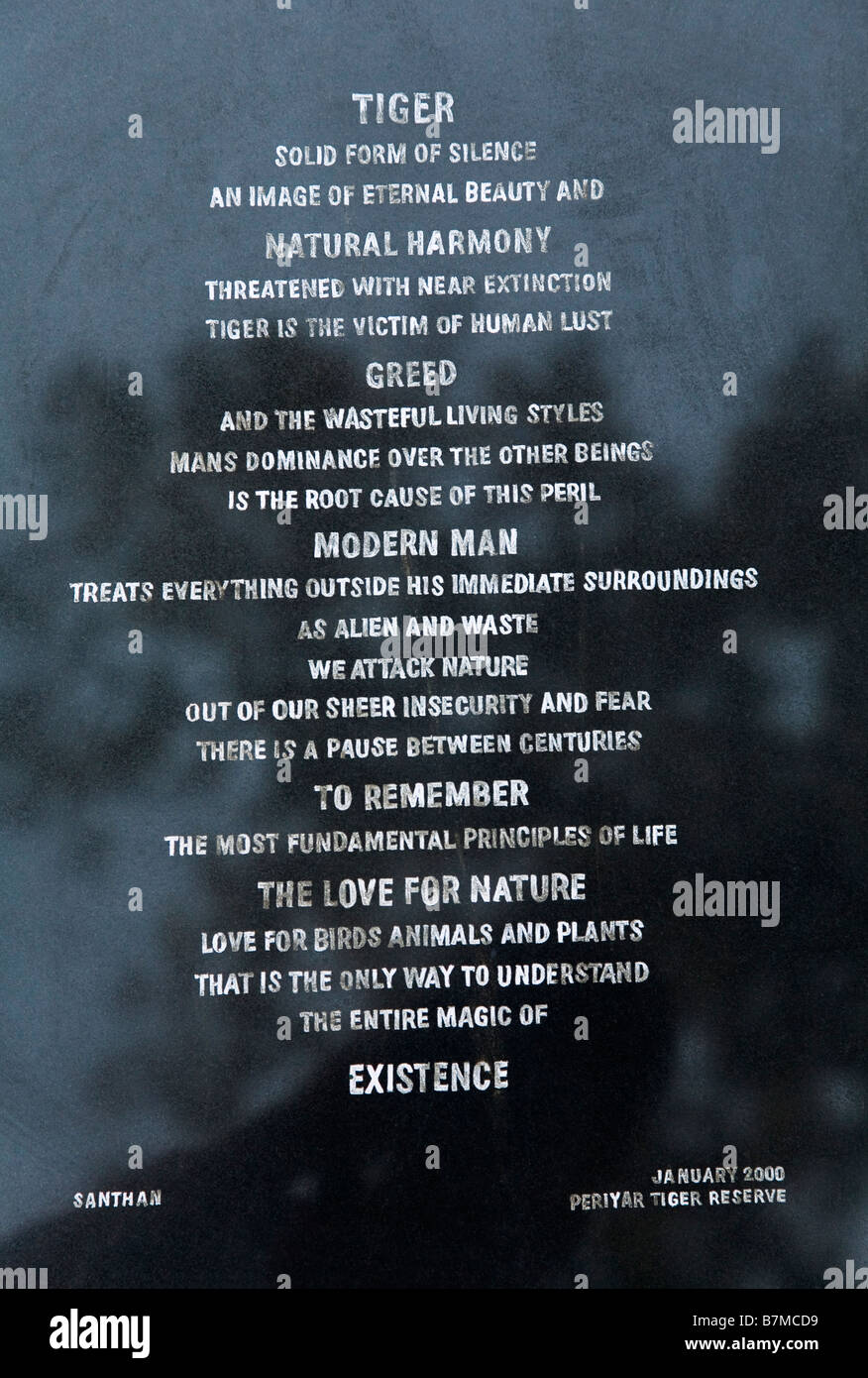 Stone plaque in Periyar Wildlife Sanctuary with a prayer for the tigers survival - Stock Image