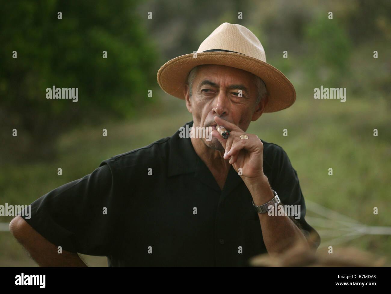 9b239c97a3b161 A man in a Panama hat smokes a Cuban cigar Stock Photo: 21962475 - Alamy