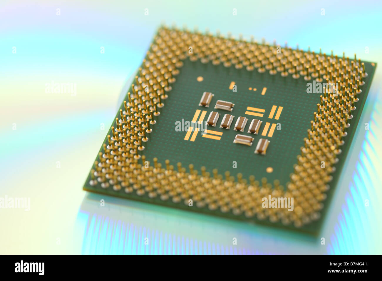 Computer CPU processor chip on green reflective background - Stock Image