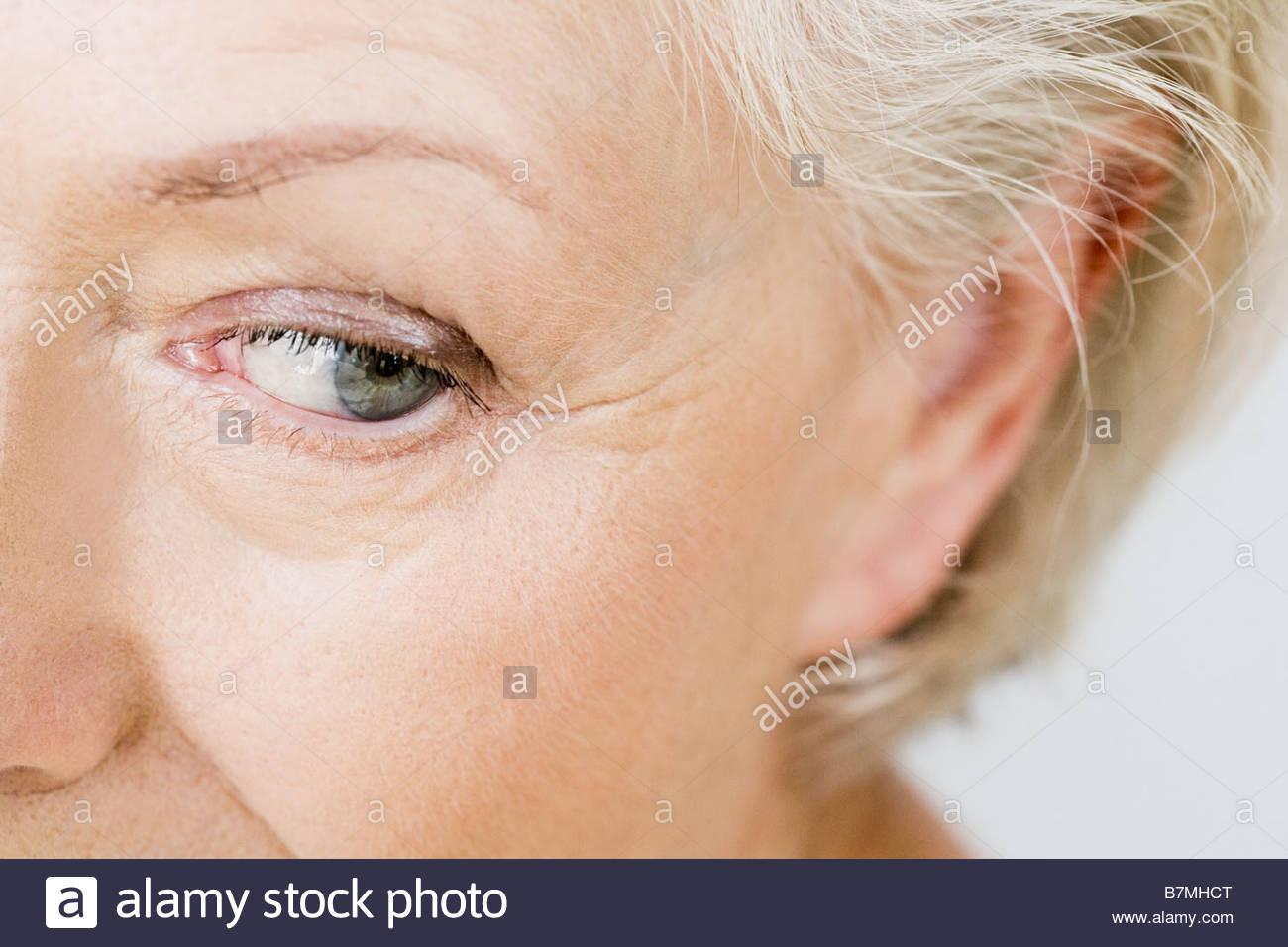 A portrait of a senior woman, detail of eye - Stock Image