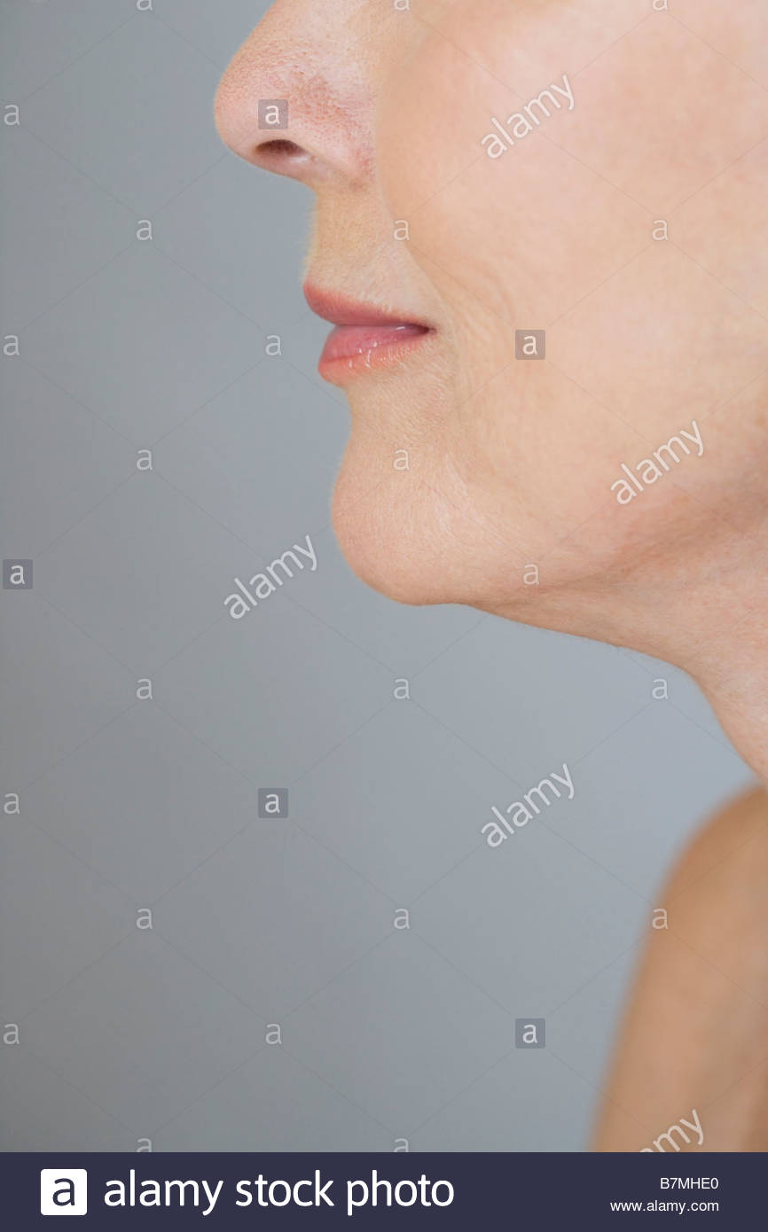 A detail of a senior woman's face, left cheek and jawline - Stock Image