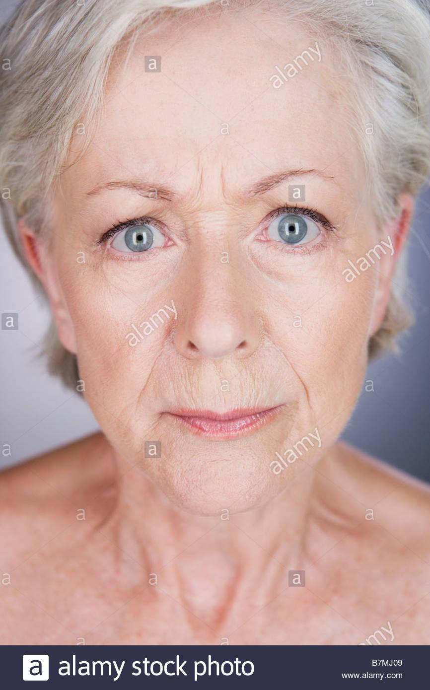 A senior woman looking anxious - Stock Image