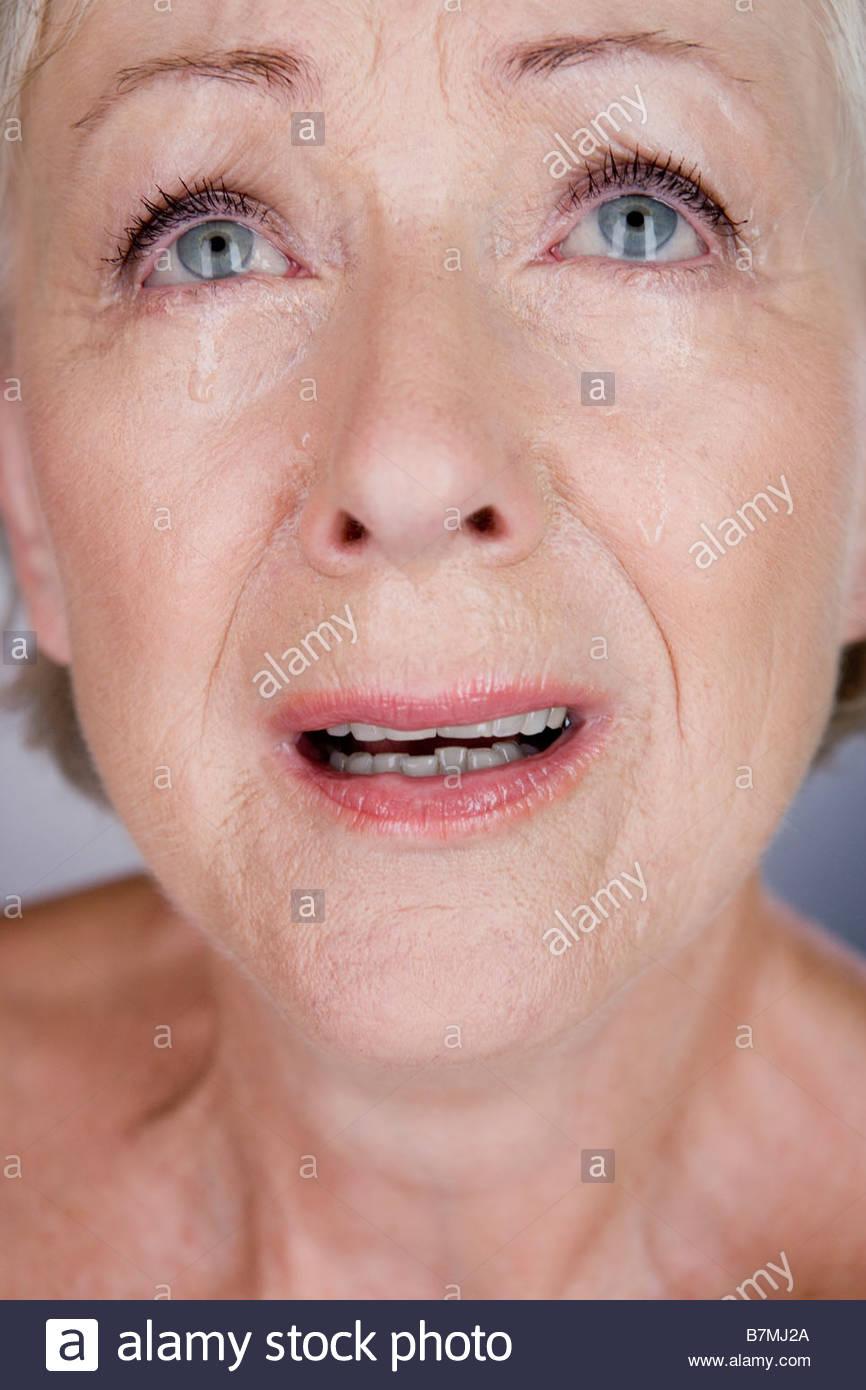 A senior woman crying - Stock Image