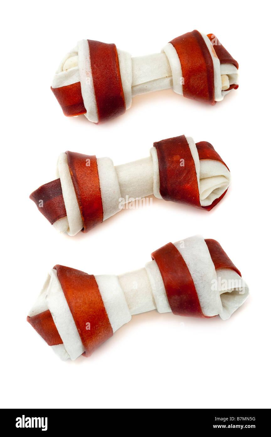 Three 3 cowhide dog chew bones - Stock Image