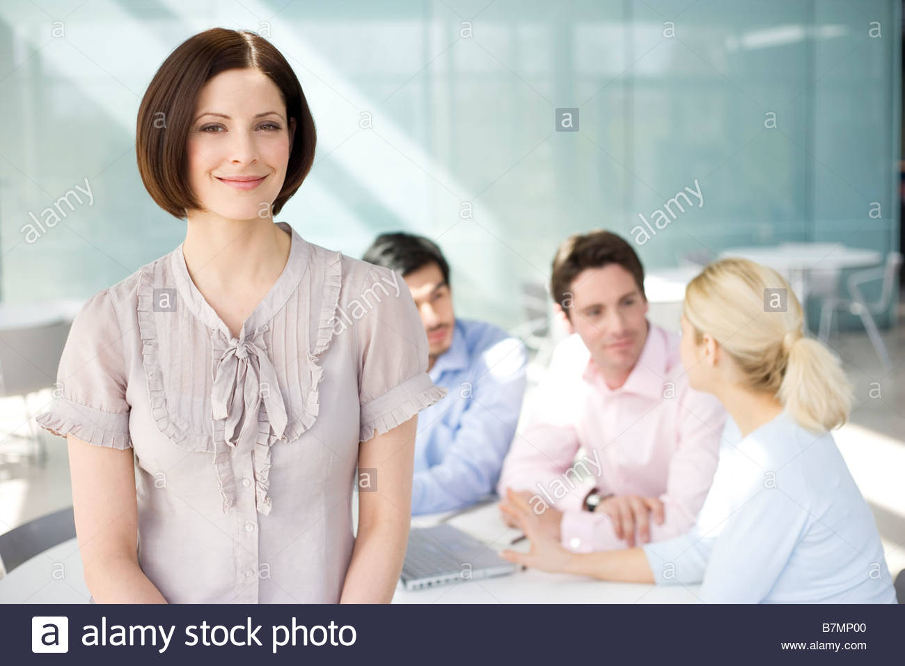 A female business project leader at a team meeting Stock Photo