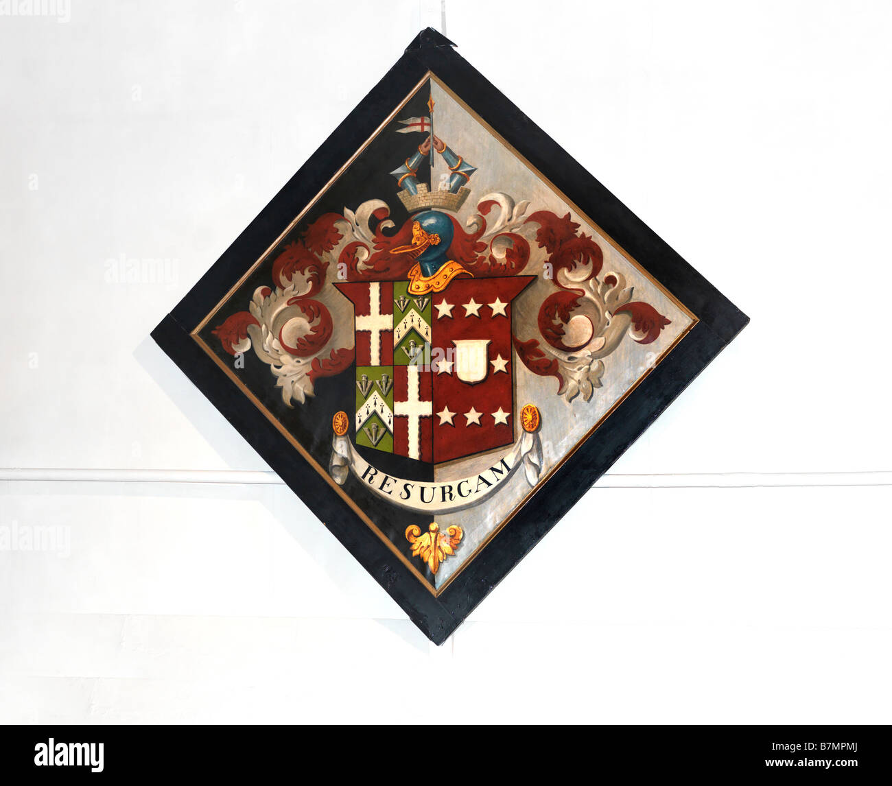 Hachment Heraldry with the words Resurgum Latin for I shall rise again St Lawrence Church Morden Surrey England - Stock Image