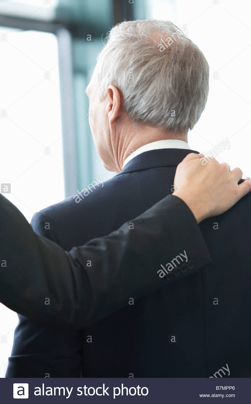 A mature businessman leaving an office building - Stock Image