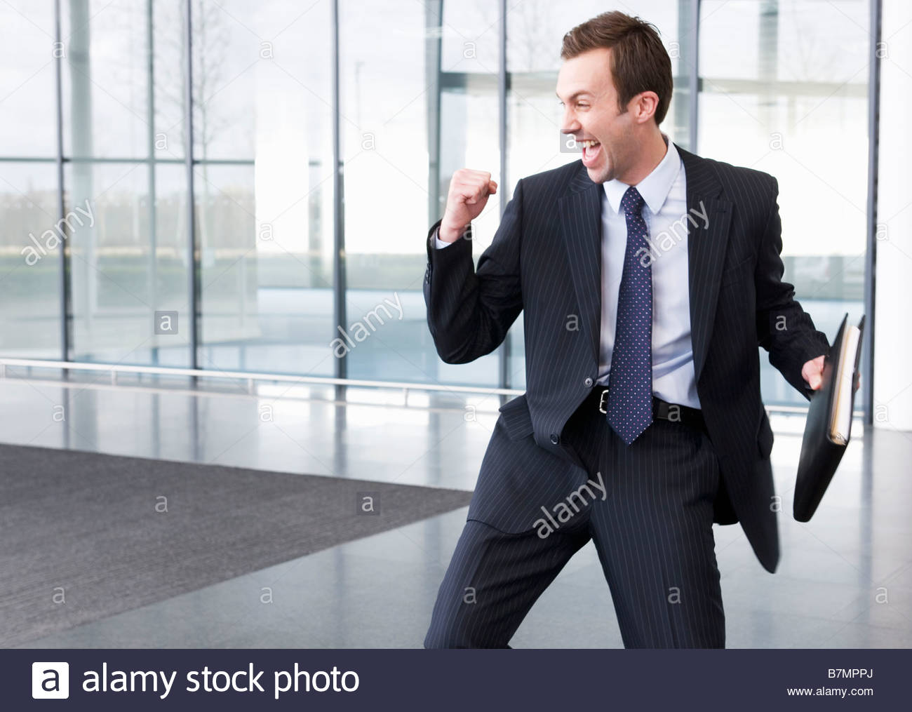 A successful job applicant or businessman making a triumphal gesture - Stock Image