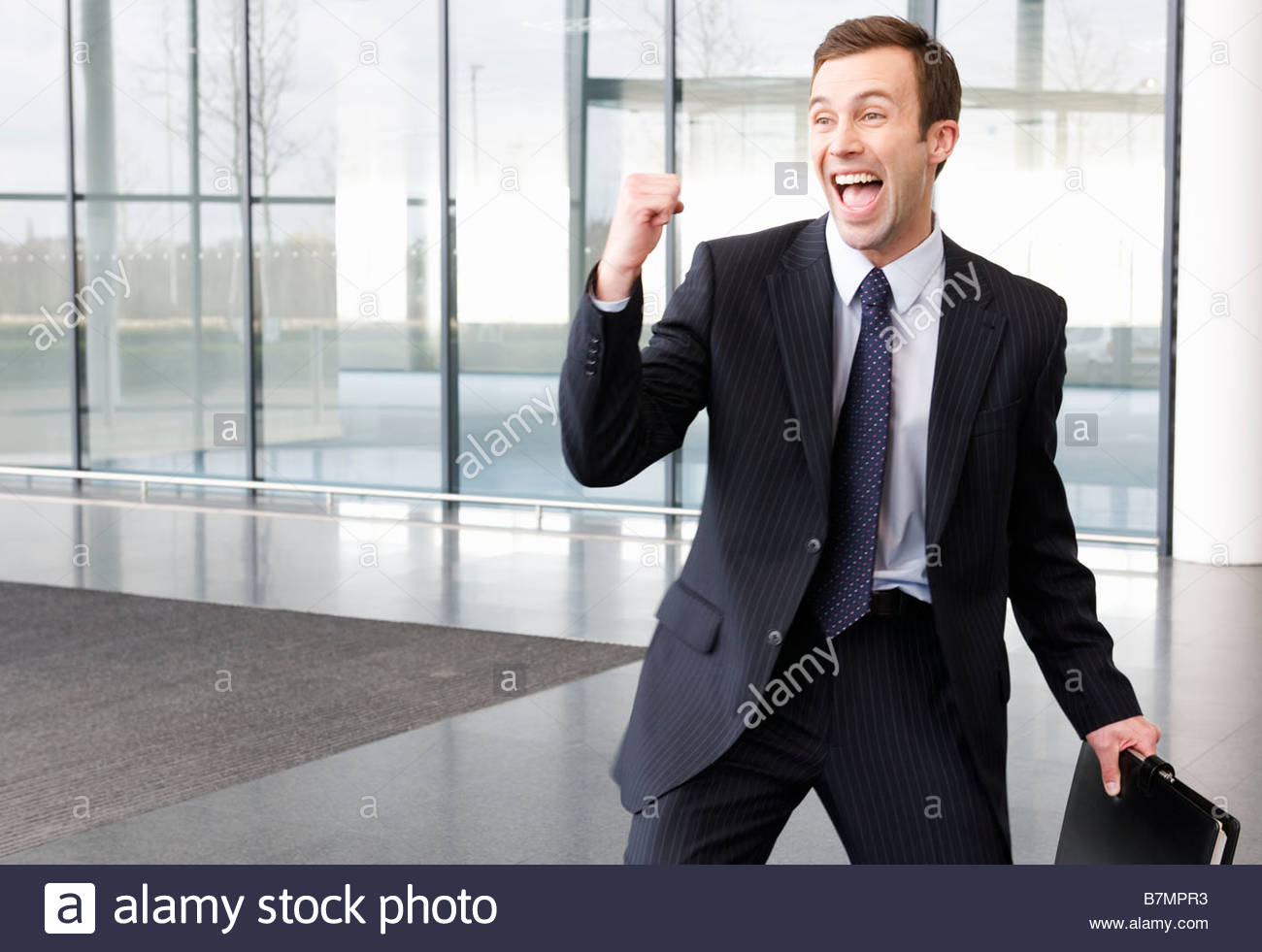 A successful job applicant or businessman making triumphal gesture - Stock Image