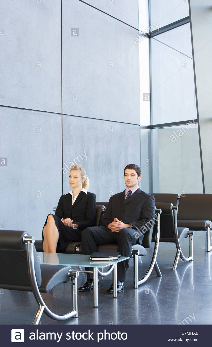 Two job candidates sitting in a waiting room Stock Photo