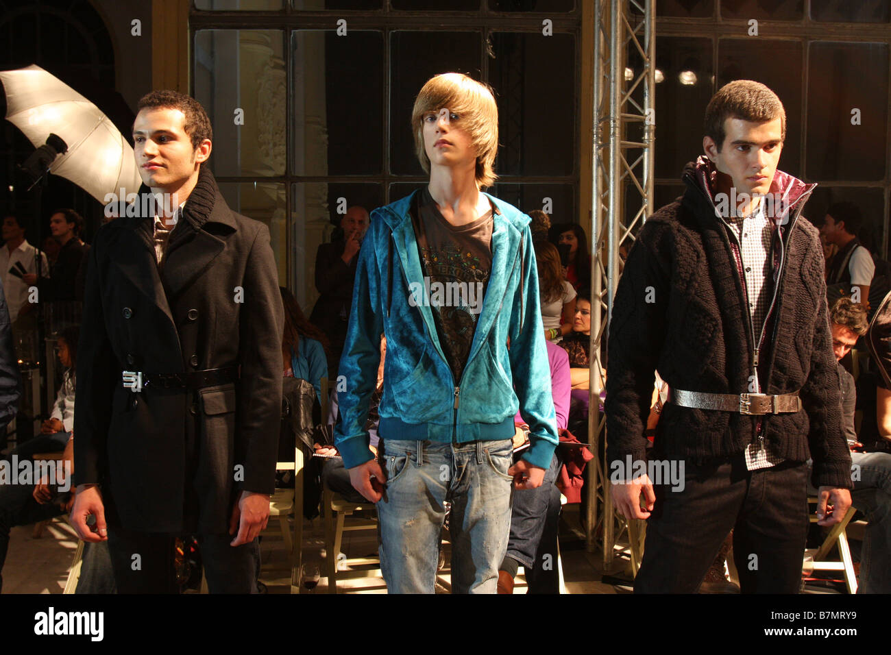 Young models during a fashion show. - Stock Image