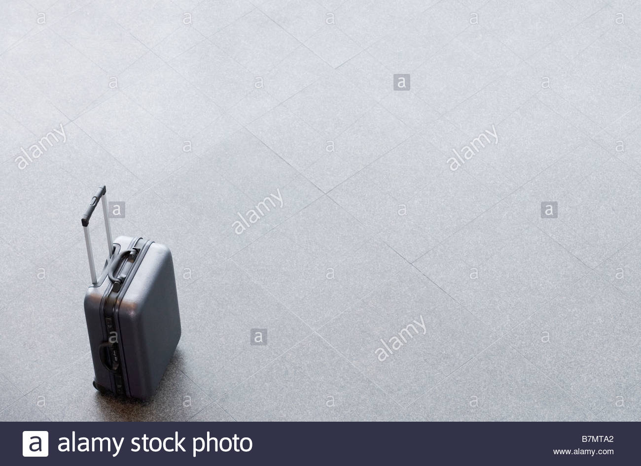 An unattended suitcase - Stock Image