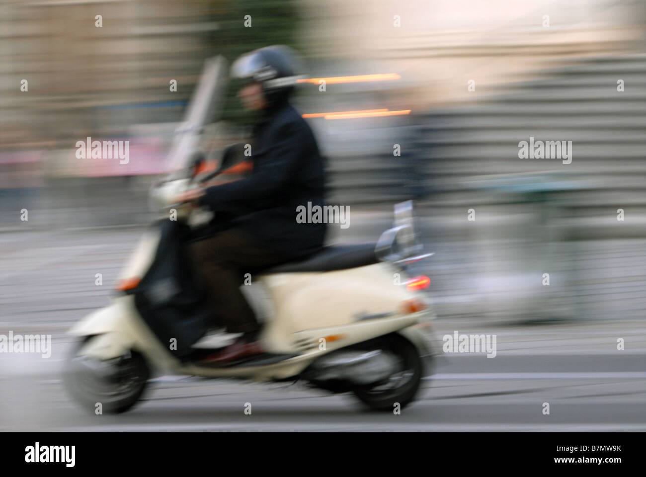 A scooter rider on Via XX Septembre, Turin, Piedmont, Italy. - Stock Image