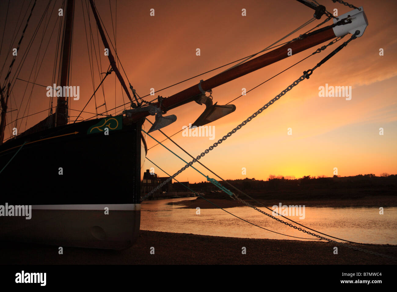 A sailing ship with winter sunset behind - Stock Image