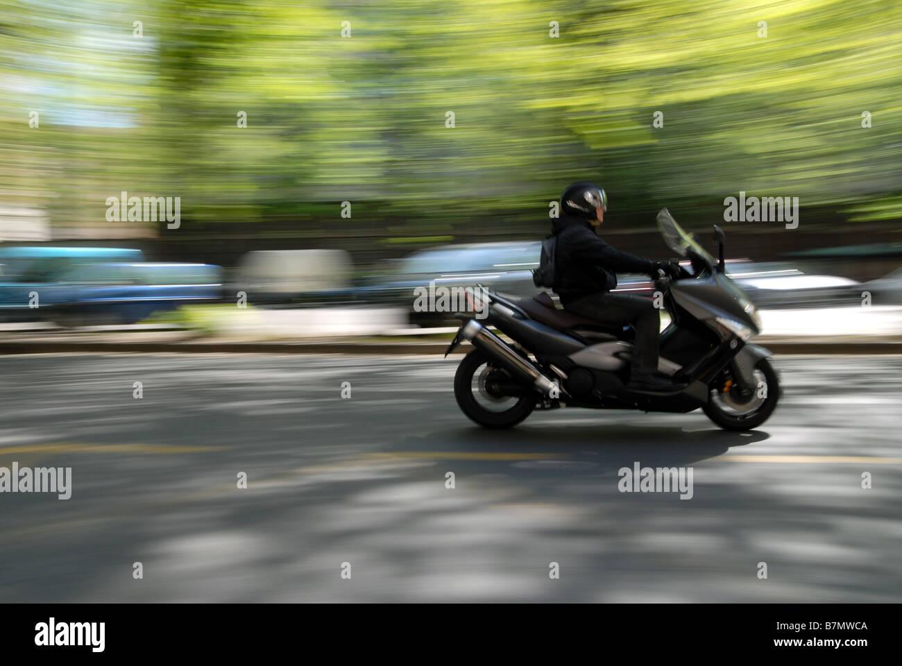 A scooter rider on Corso Galileo Ferraris, Turin, Piedmont, Italy. - Stock Image