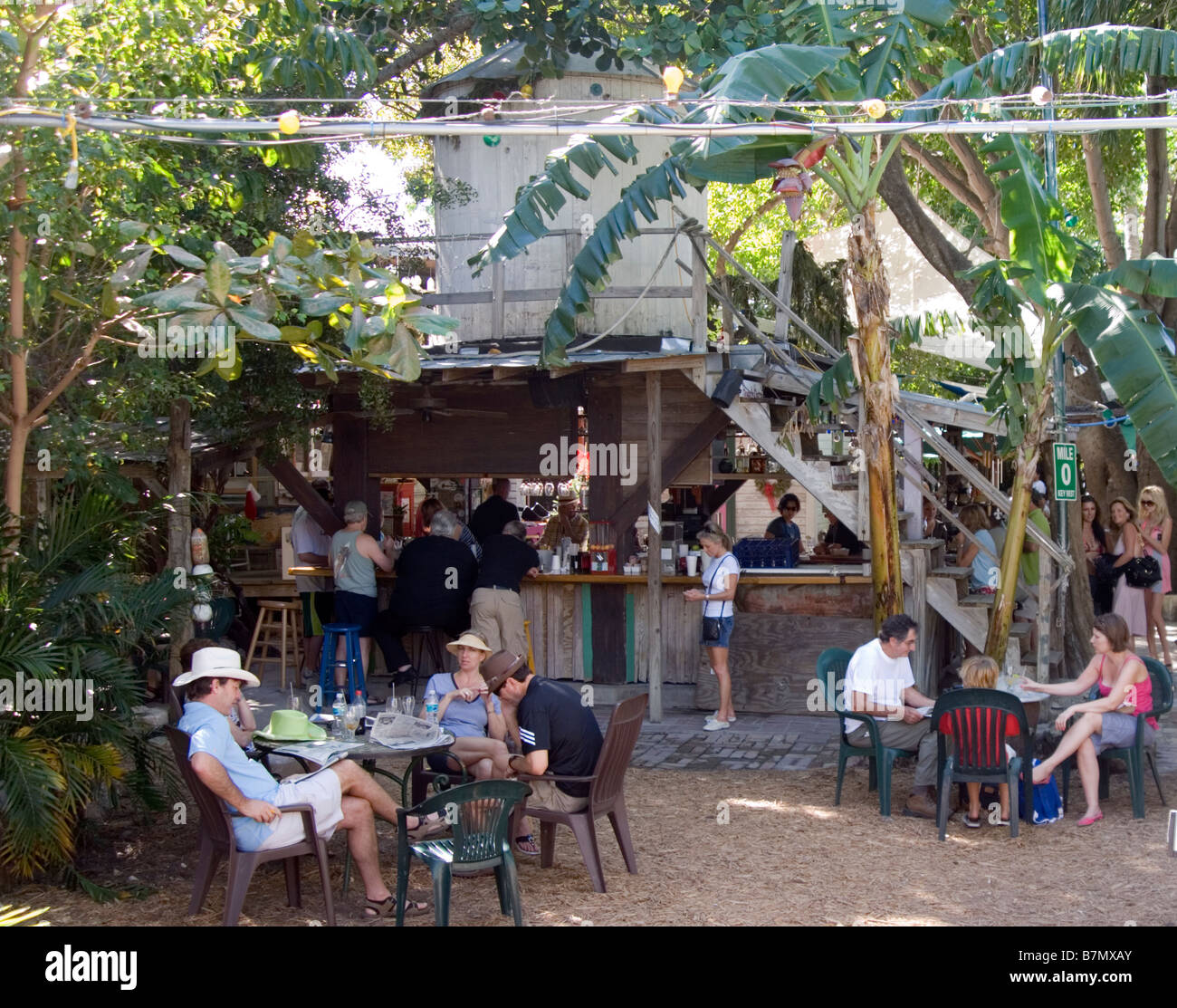 relaxing in the blue heaven restaurant key west - Stock Image