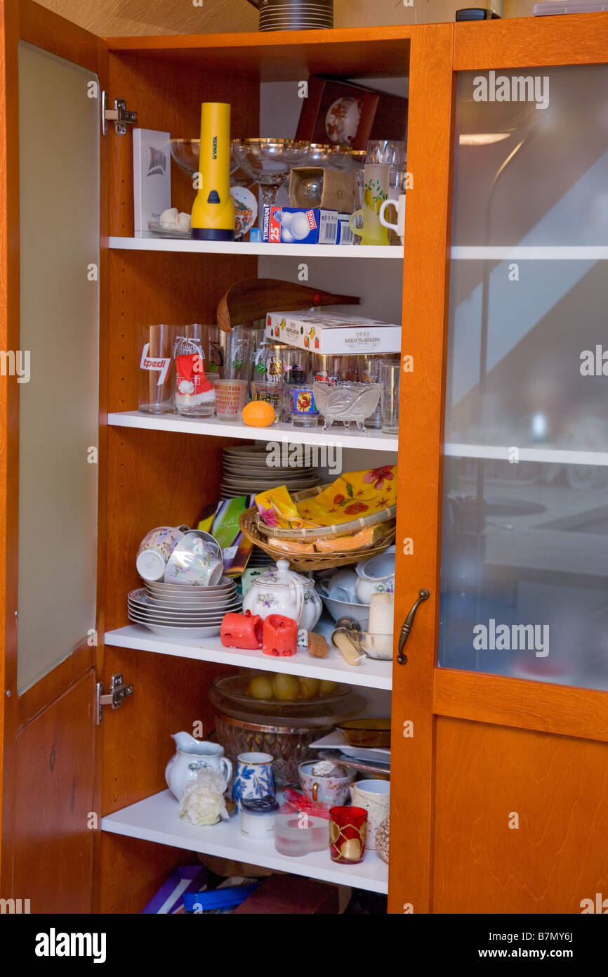 Messy Kitchen Glass Cabinet With Dishes