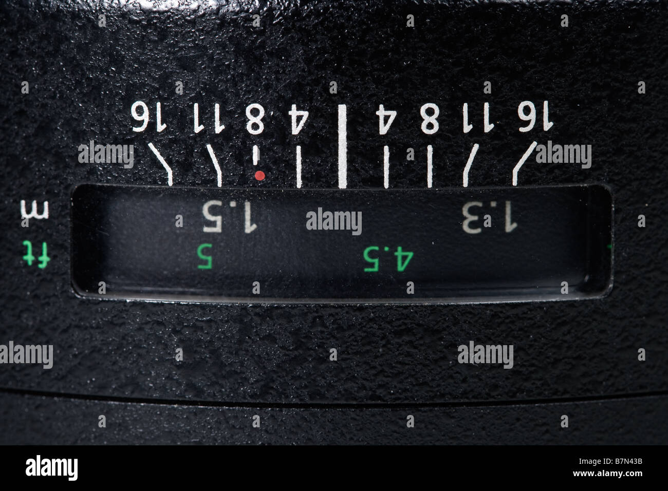 DOF and distance scale on camera lens - Stock Image