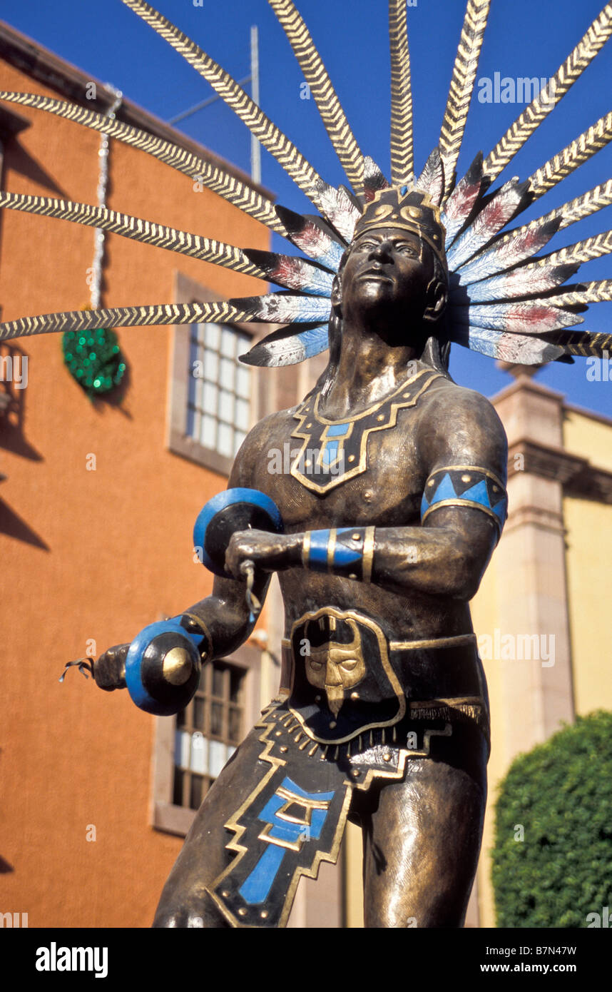 Plumed Indian dancer near Templo de San Francisco in the Spanish Colonial city of Santiago de Queretaro, Queretaro, - Stock Image